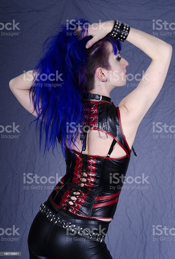Rear view profile of woman with hands in hair. royalty-free stock photo