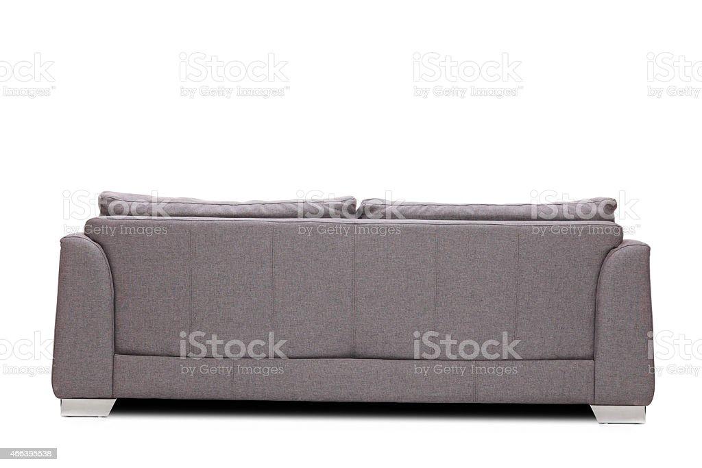 Rear view studio shot of a modern gray sofa stock photo