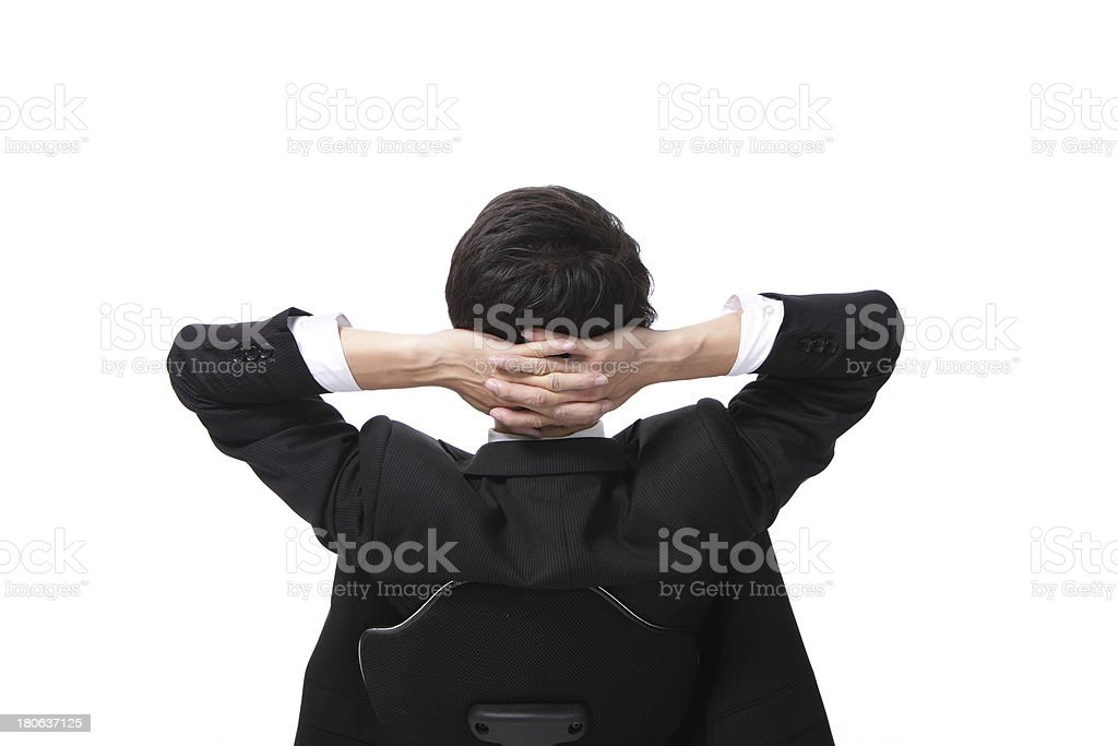 Rear viwe of a relaxed businessman royalty-free stock photo