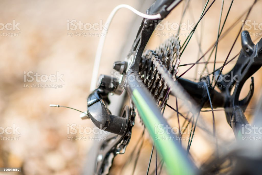 Close-up view of rear wheel of bicycle with chain and sprocket on...