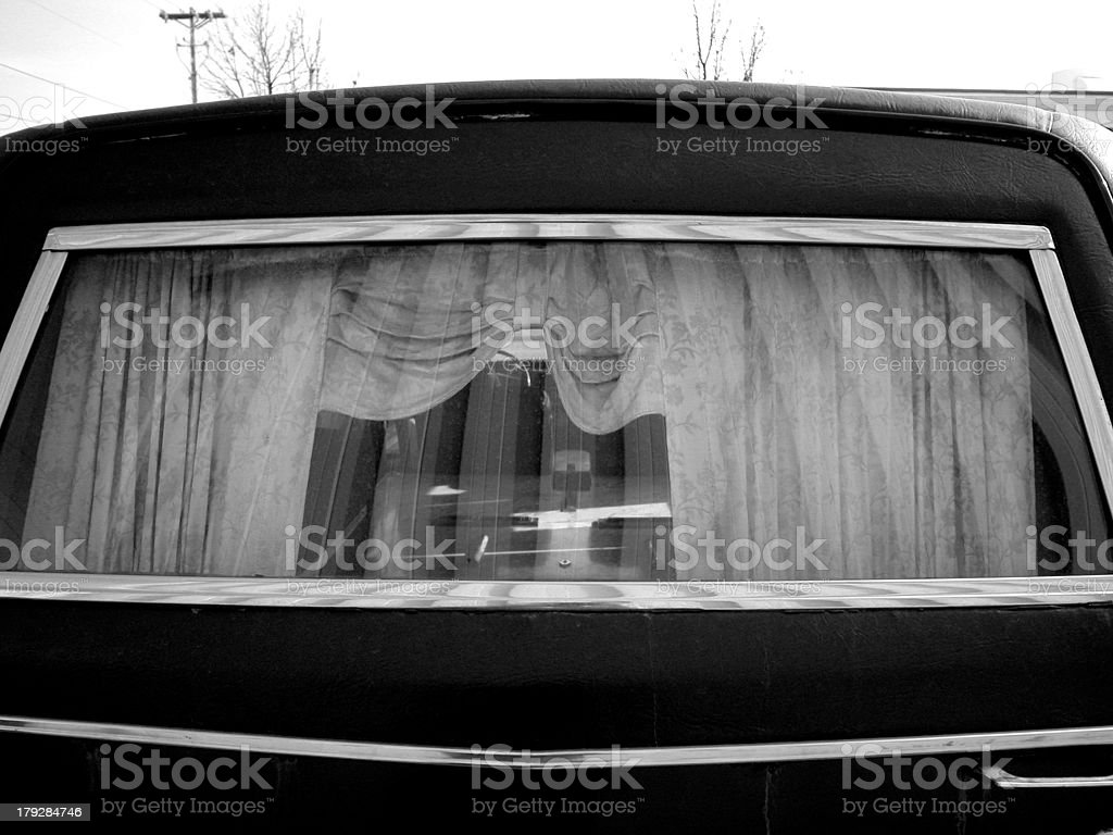 Rear window of a hearse or funeral coach stock photo