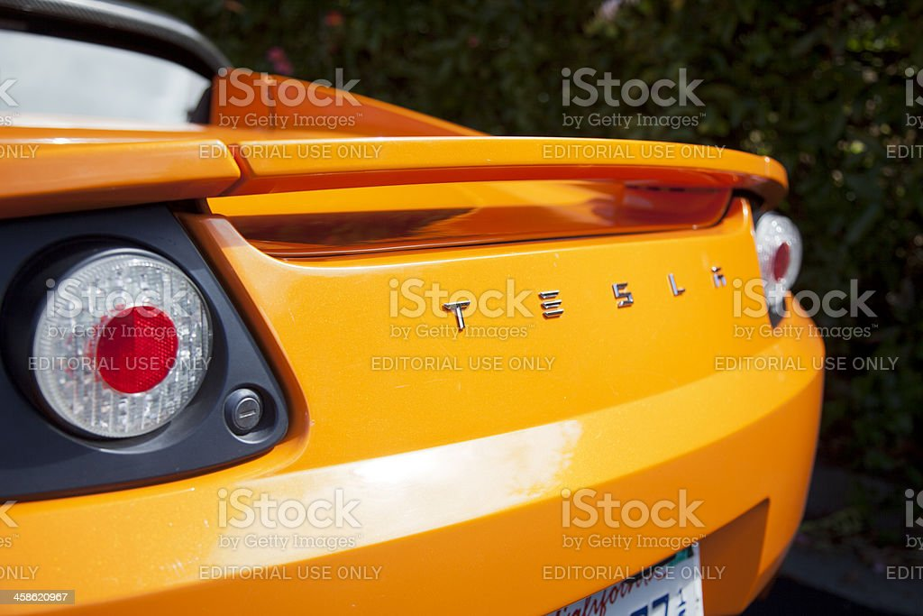 Rear-end view of an orange convertible stock photo