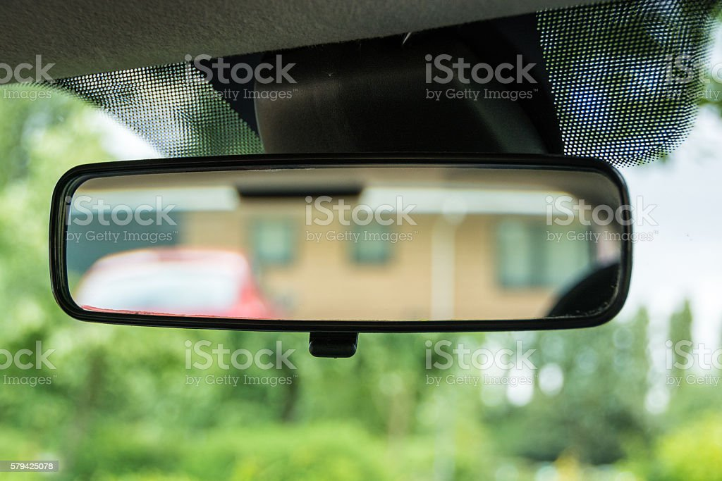Rear-view mirror in a car in green environment stock photo