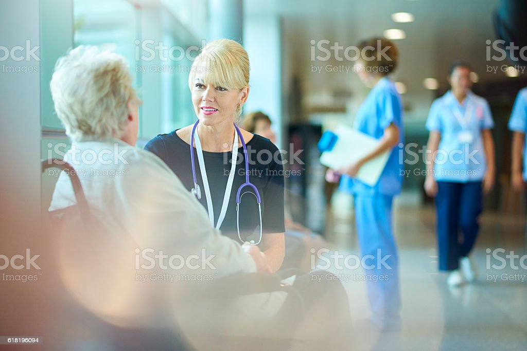 reassuring the patient stock photo