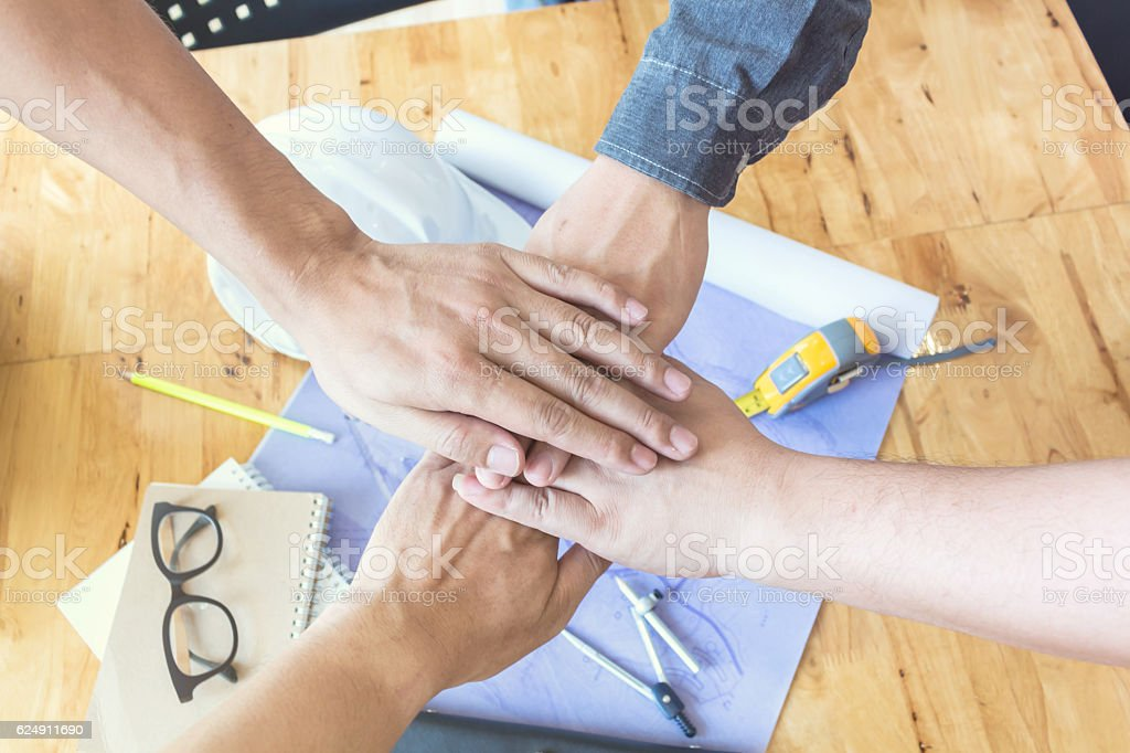 reative group of designers putting hands together. Team work. stock photo