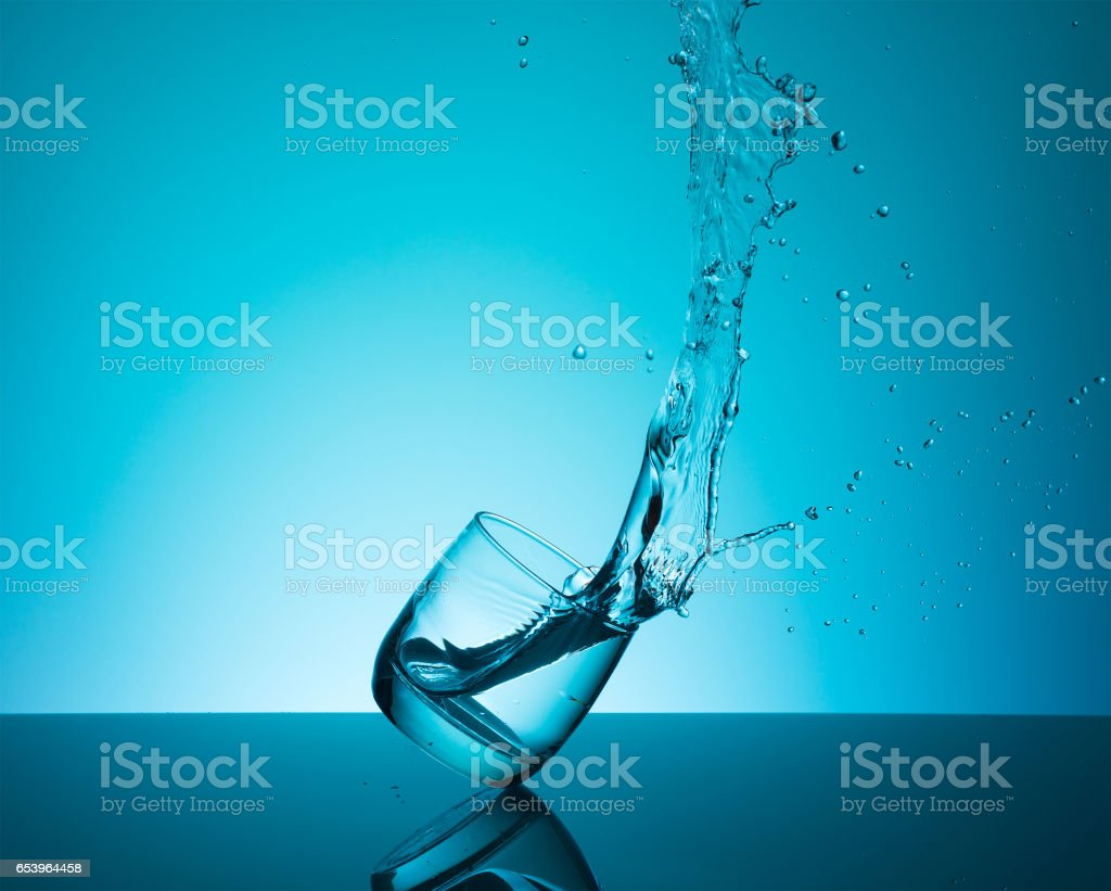 Сreative splashing water in the glass stock photo
