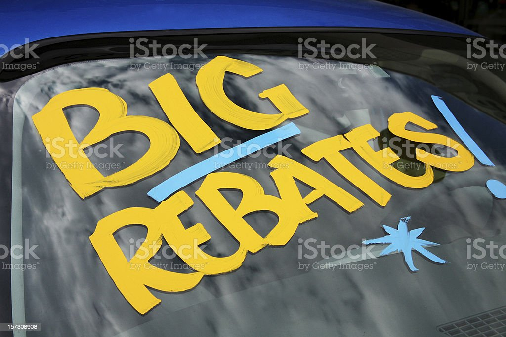 Rebates on vehicles transportation dealership car lot window royalty-free stock photo