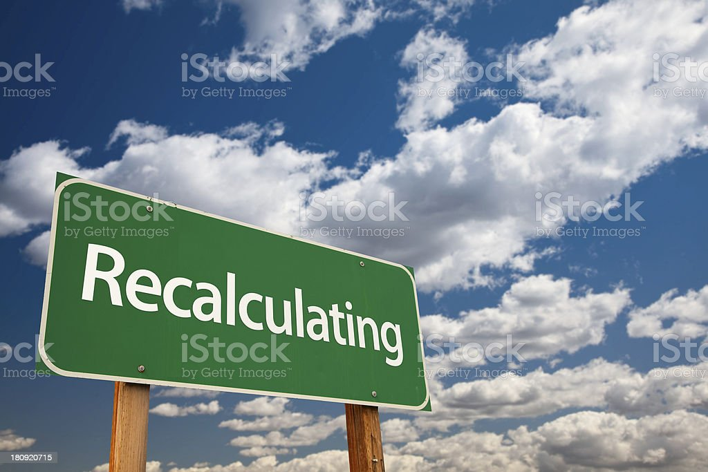 Recalculating Green Road Sign with Sky stock photo