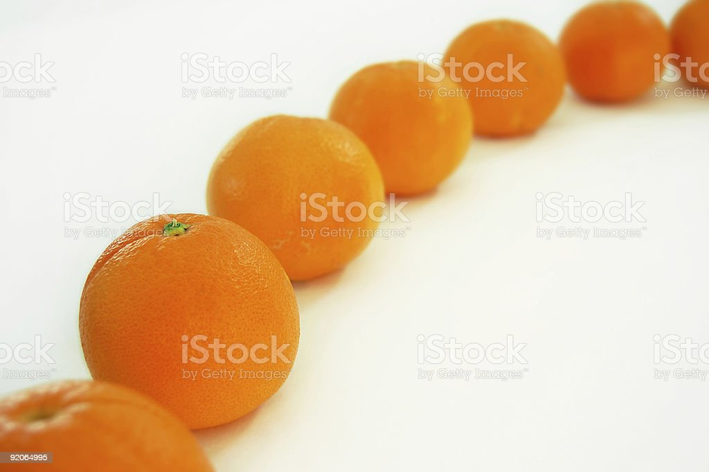 Receding Oranges stock photo