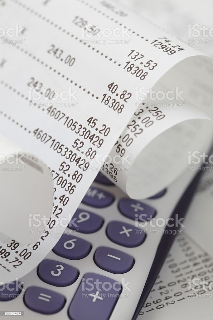 Receipt and calculator, purchase checking stock photo