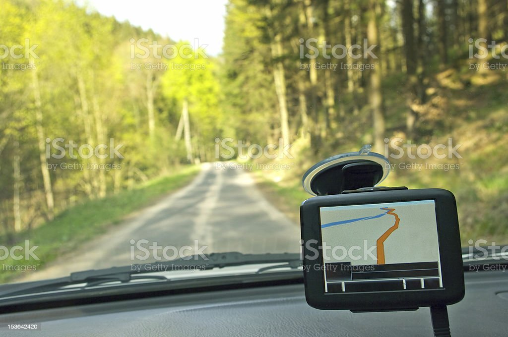 GPS receiver above car dash on forest road stock photo
