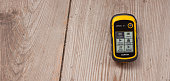 GPS receiver is recordind positioning log over a  wooden background