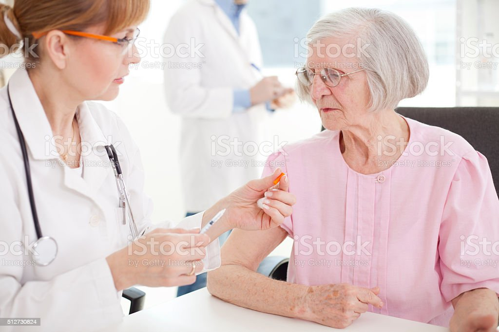 Receives an injection of insulin stock photo