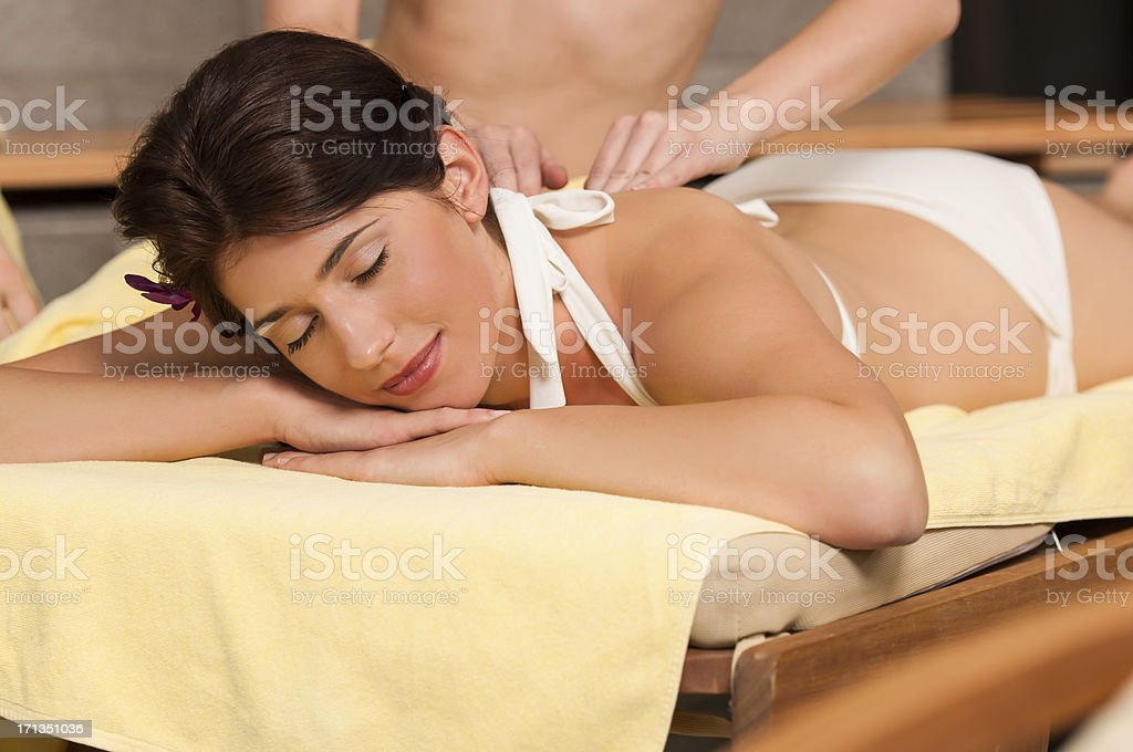 Receiving back massage stock photo