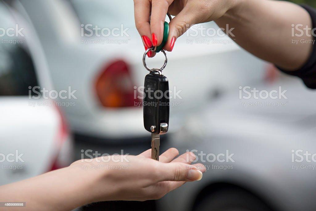 Receiving car key of a new car. stock photo