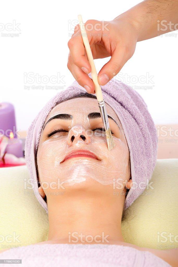 Receiving Facial Mask At Spa royalty-free stock photo