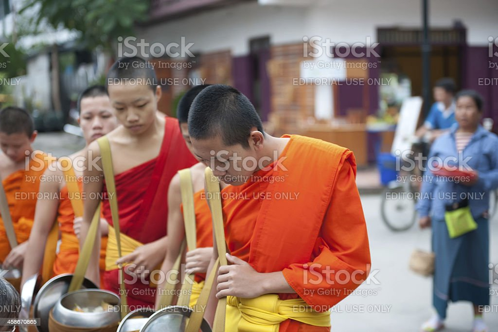 Receiving food offerings royalty-free stock photo