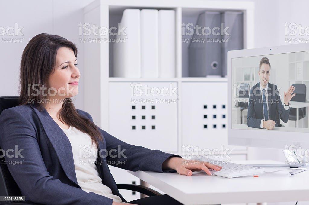 Receiving good news from her overseas partner stock photo
