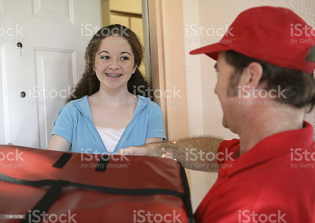 Receiving Pizza Delivery stock photo