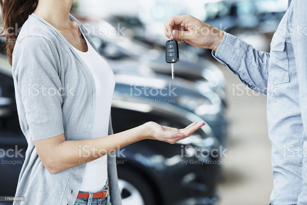 Receiving the keys to her new car stock photo