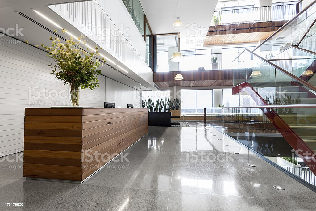 Reception area in a modern, brightly lit office space stock photo
