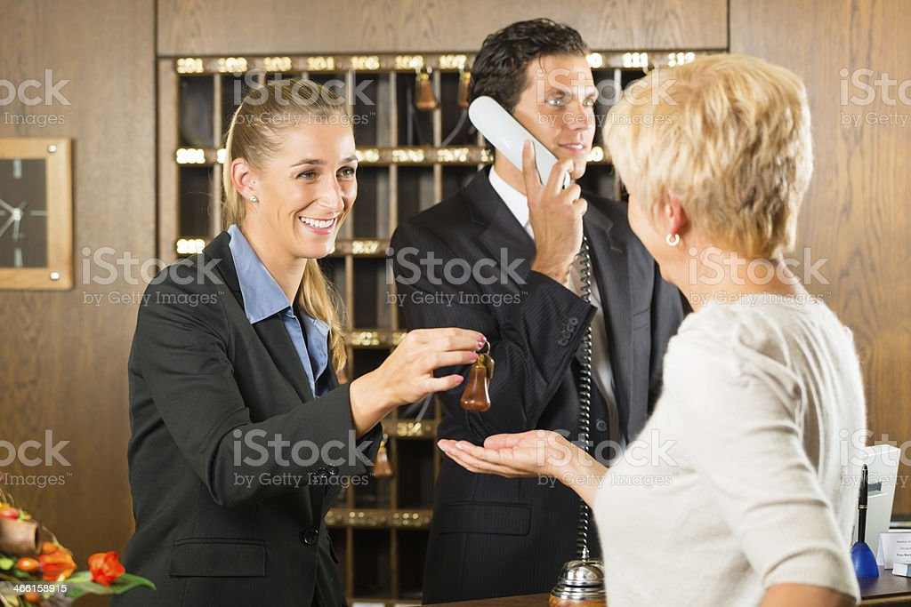 Reception - Guest checking in a hotel stock photo