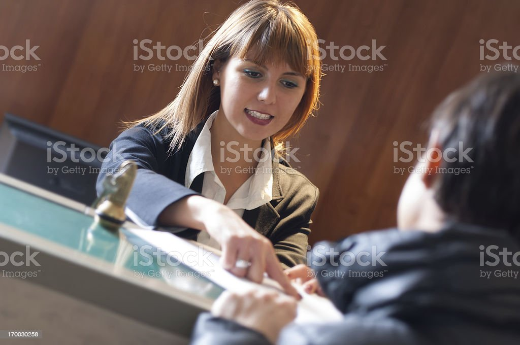 Receptionist and Hotel Check In stock photo