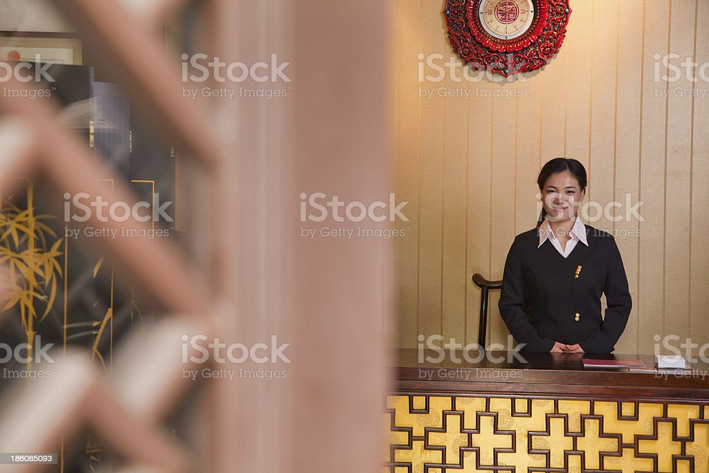 Receptionist at Hotel Front Desk stock photo