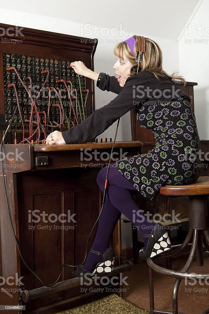 Receptionist needing telephone hardware upgrade stock photo