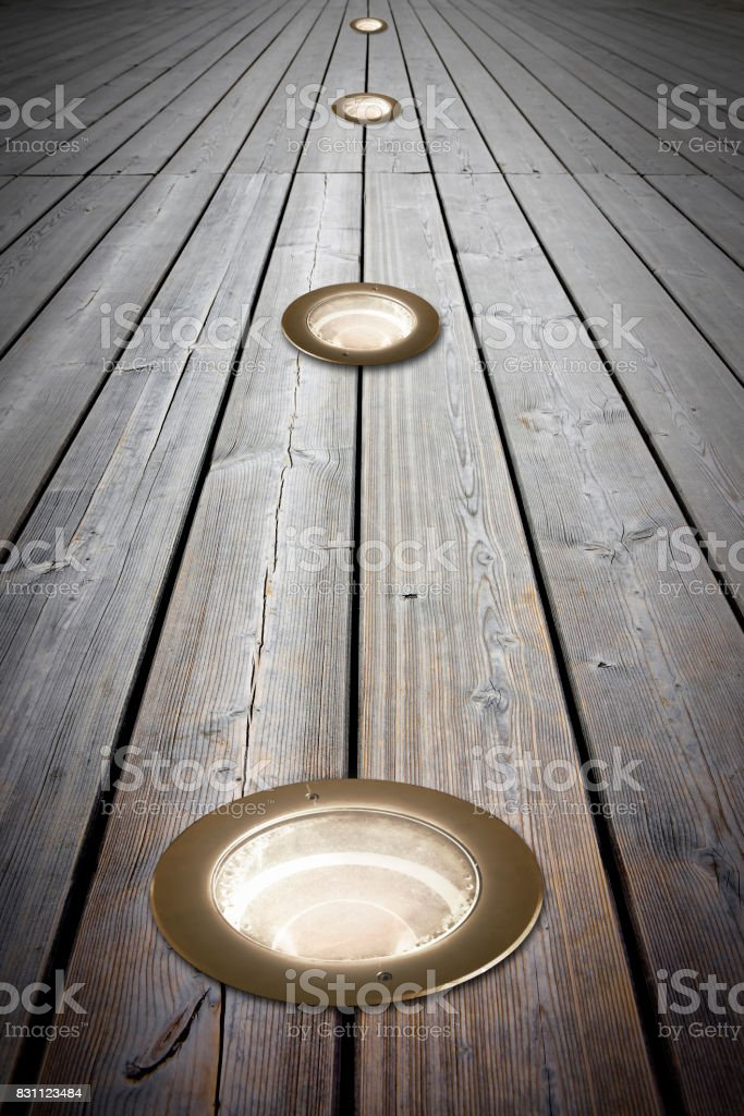 Recessed floor lamp on wooden floor - image with copy space stock photo
