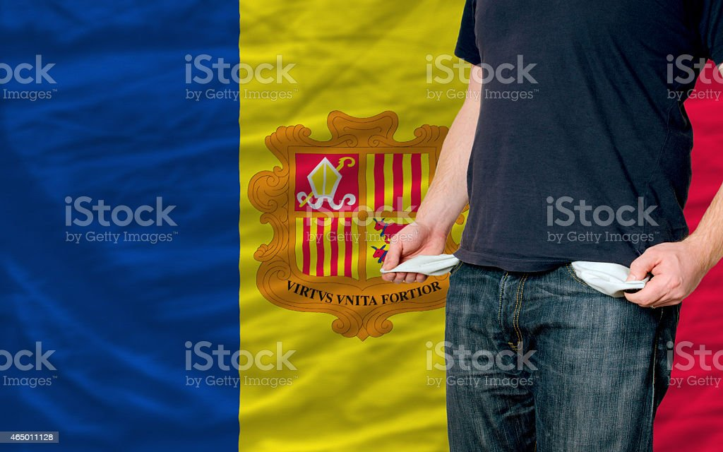 poor man showing empty pockets in front of andorra flag