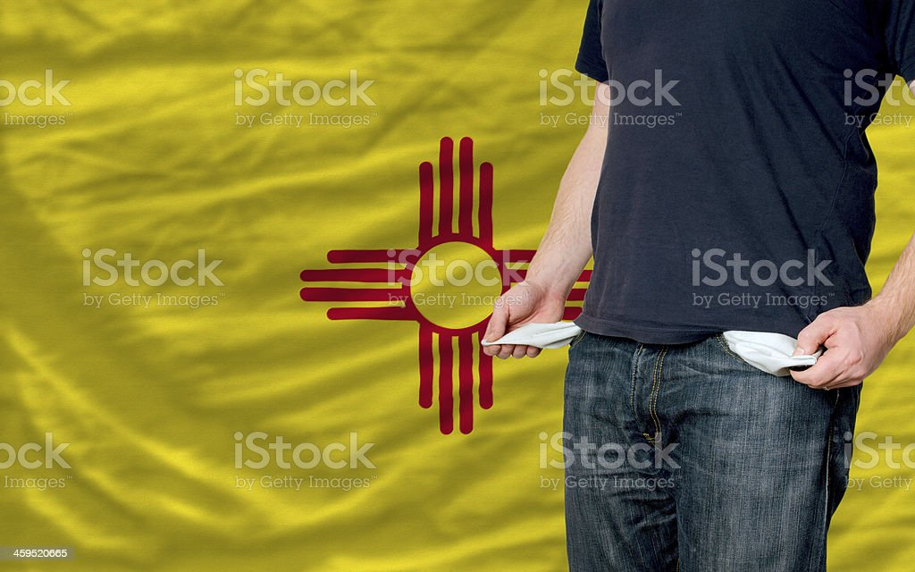 recession impact on young man and society in new mexico stock photo