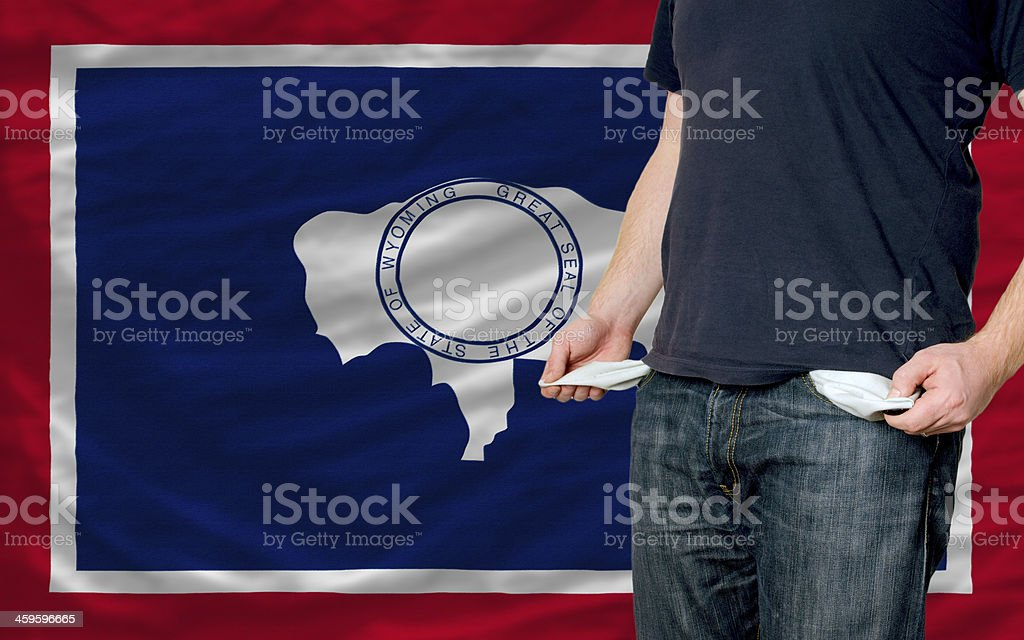 recession impact on young man and society in wyoming stock photo
