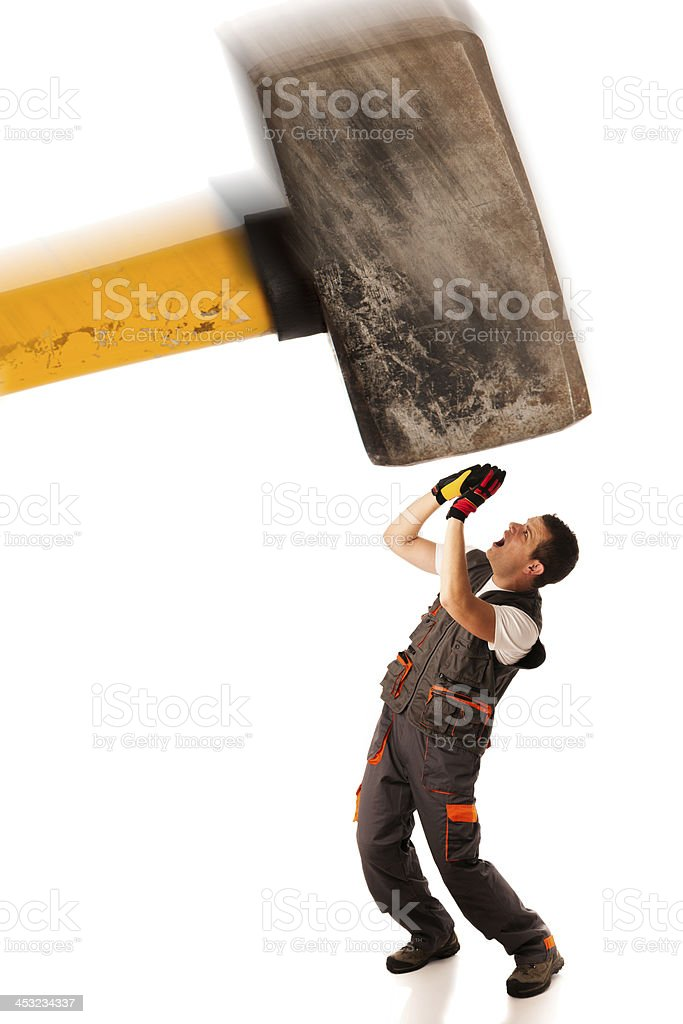 Recession strike work force - worker and enormous hammer stock photo