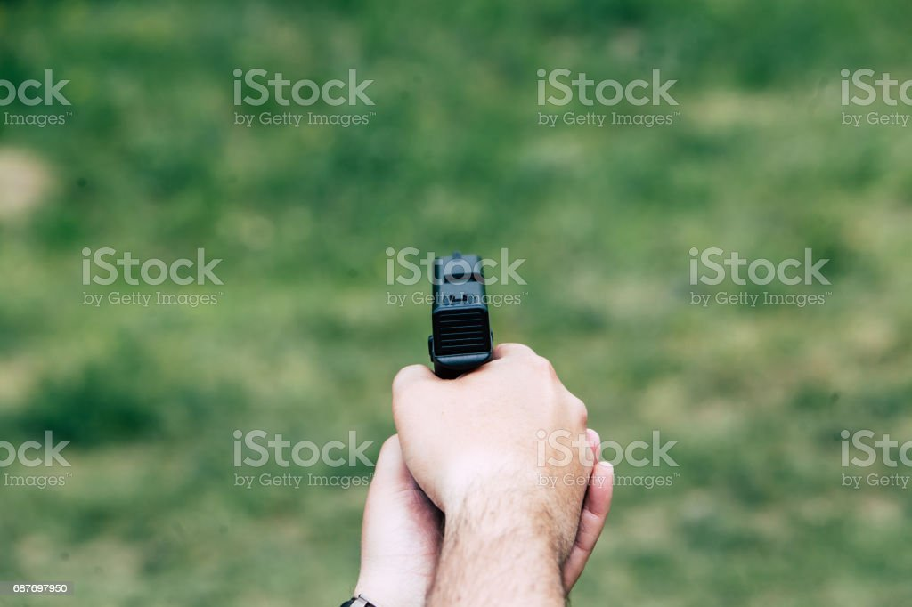 Recharge the gun in hand. Training on shooting stock photo