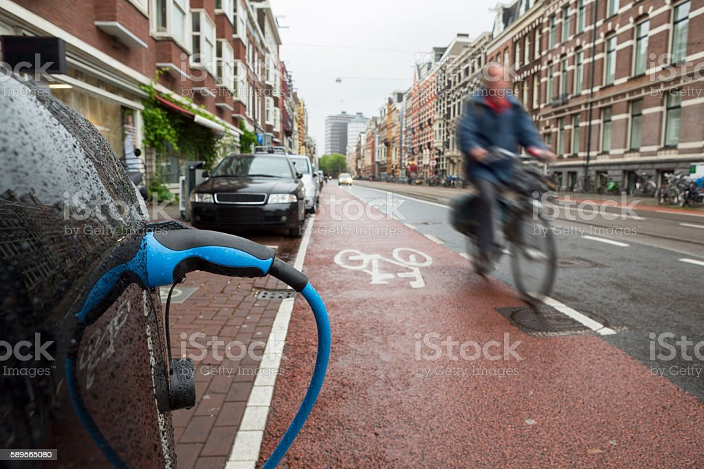 Recharging An Electric Car in Amsterdam stock photo