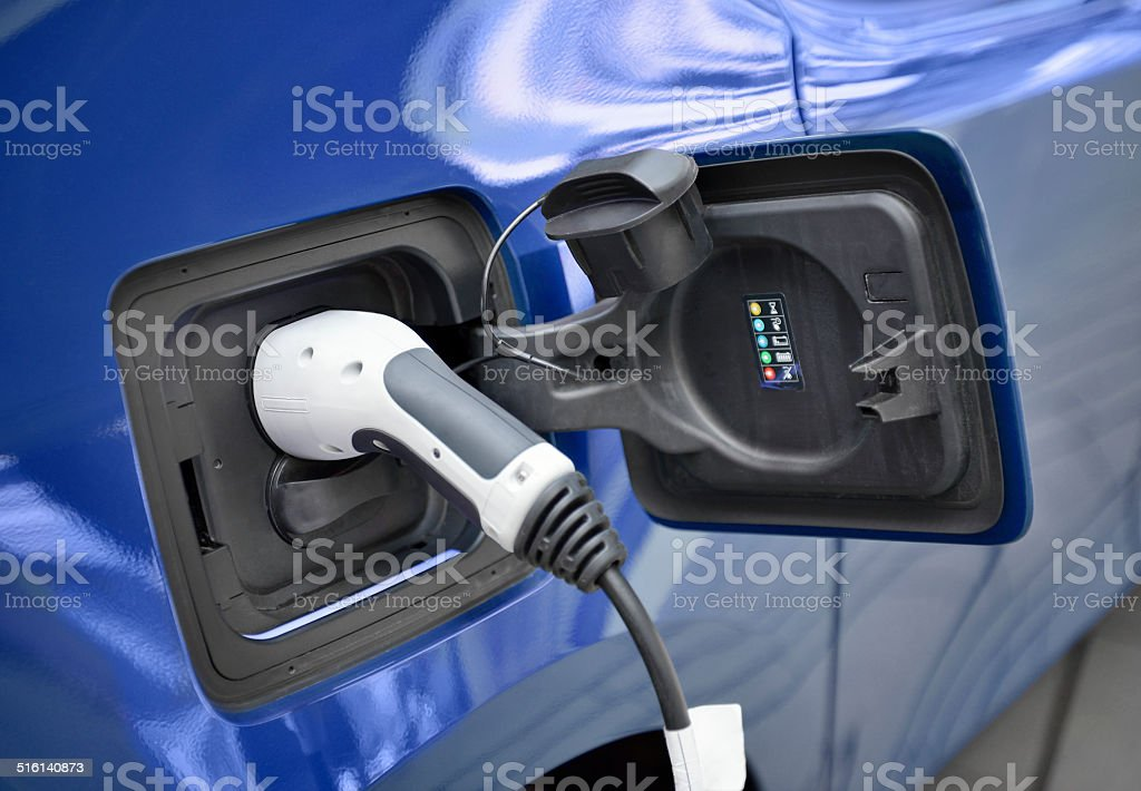 Recharging an electric car stock photo