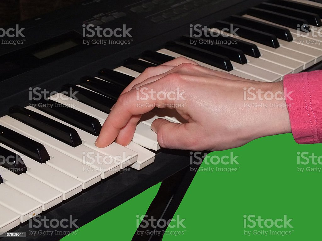 Rechte Hand spielt auf Keyboard stock photo