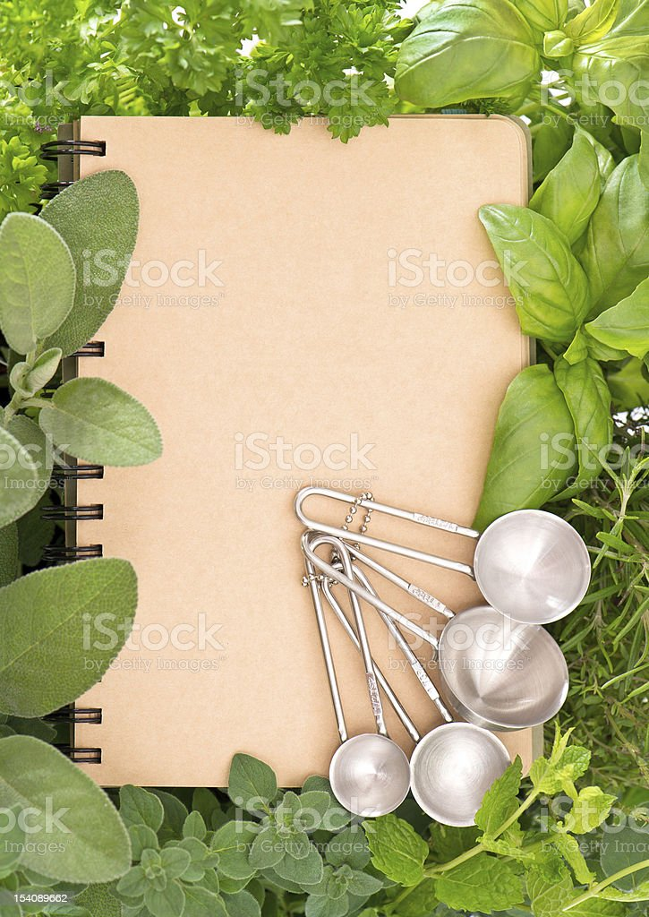 recipe book with variety fresh herbs royalty-free stock photo