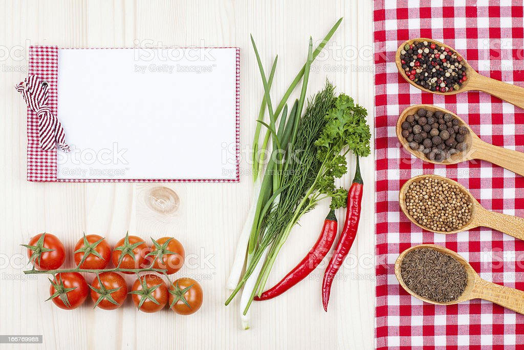 Recipe cook book, chili, cherry tomatoes, spices, tablecloth royalty-free stock photo