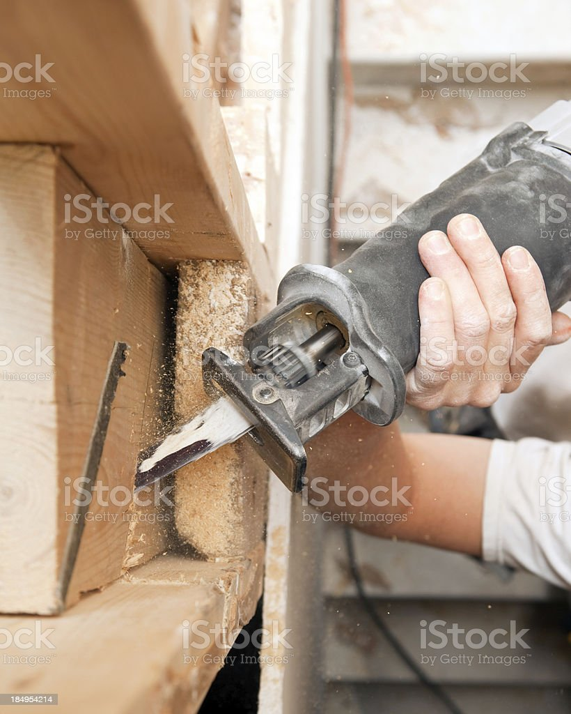 Reciprocating Saw Cutting Board for Remodeling Project stock photo