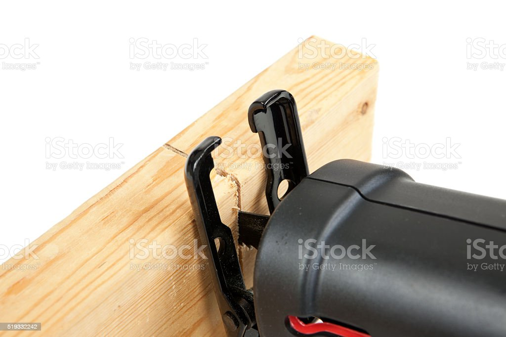 Reciprocating Saw Cutting Through a Board stock photo