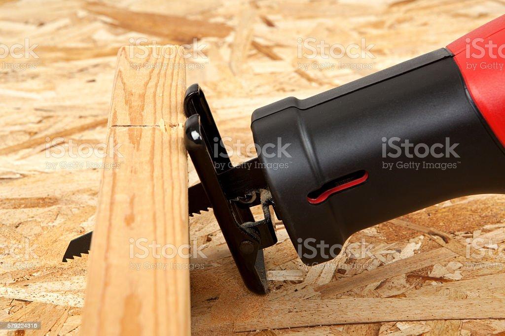Reciprocating Saw Cutting Through A Board stock photo