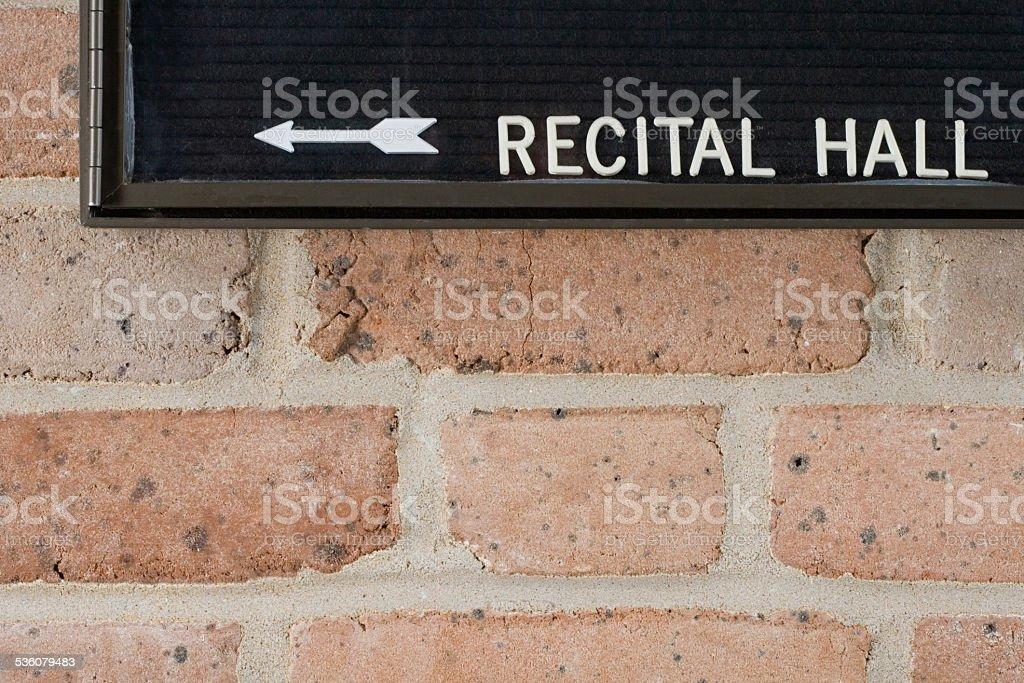 Recital hall sign on brick wall stock photo