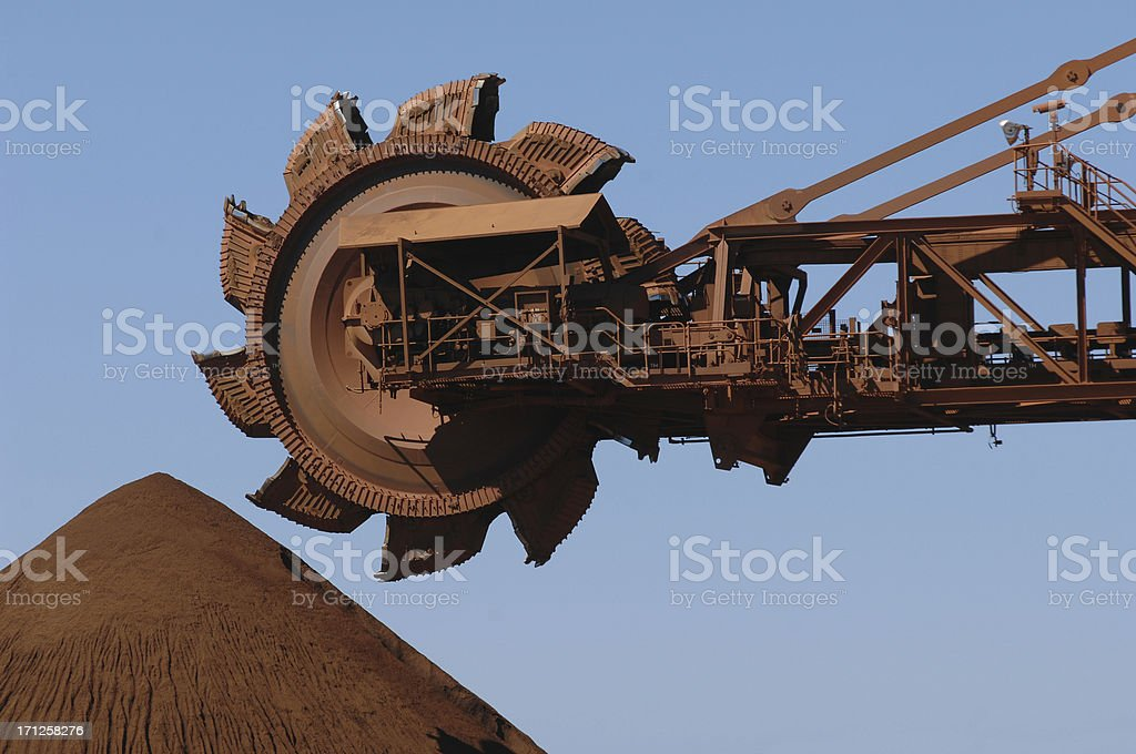 Reclaimer and Iron Ore Stockpile royalty-free stock photo
