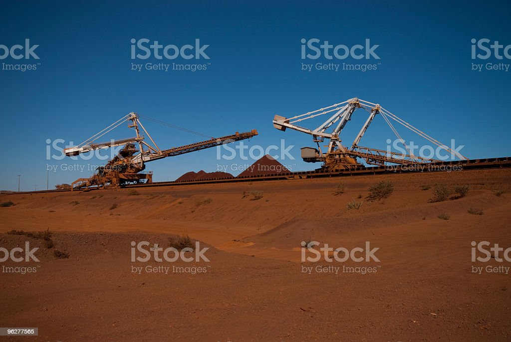 reclaimer and stacker on iron ore side stock photo