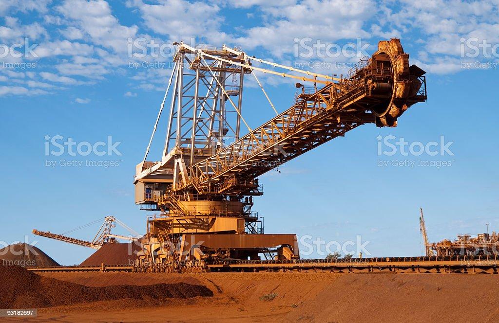 reclaimer on iron ore site stock photo