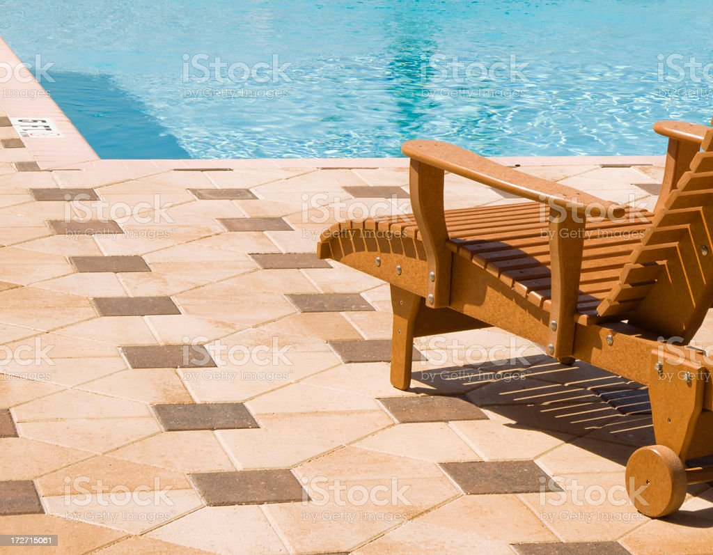 Recliner chair by the pool royalty-free stock photo