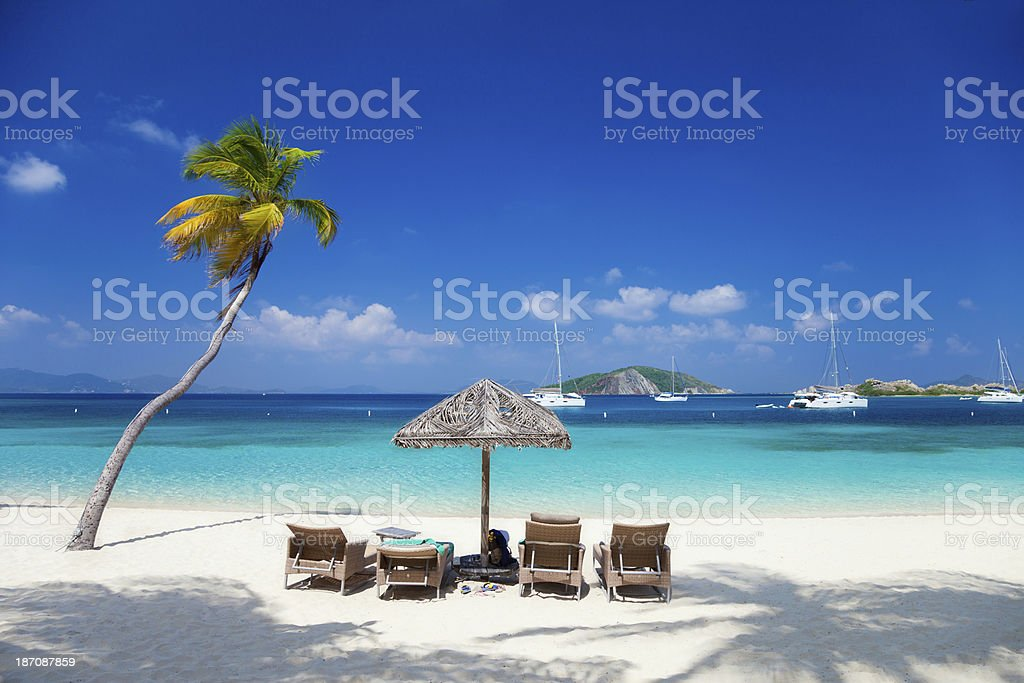 recliners at a beach in Deadman's Bay, Peter Island, BVI stock photo