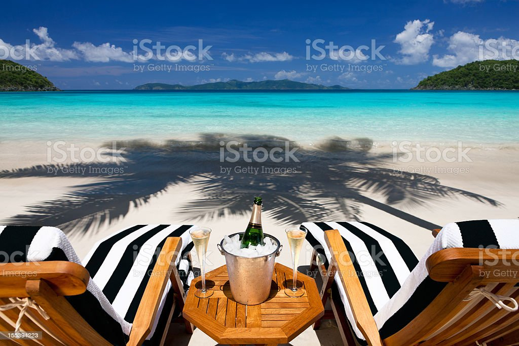 recliners with champagne at a tropical Caribbean beach stock photo